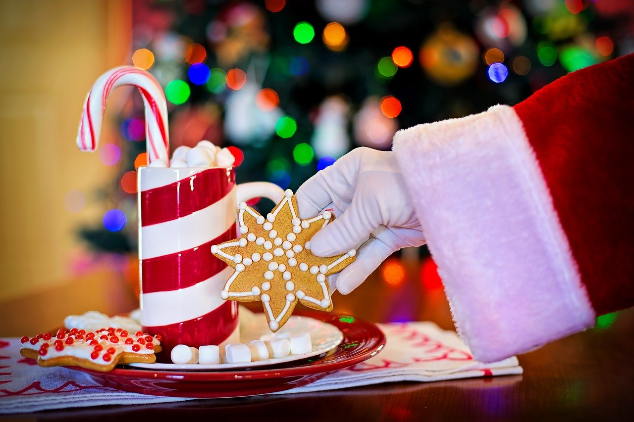 Santa Claus grabbing a cookie